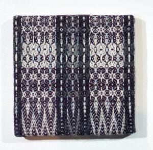 Handwoven textile wall art – Burgundy Medallion